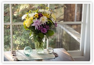 Flower bouquet near window